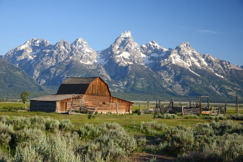 The historic barn or homestead along Mormon Row with the Teton Range in the background