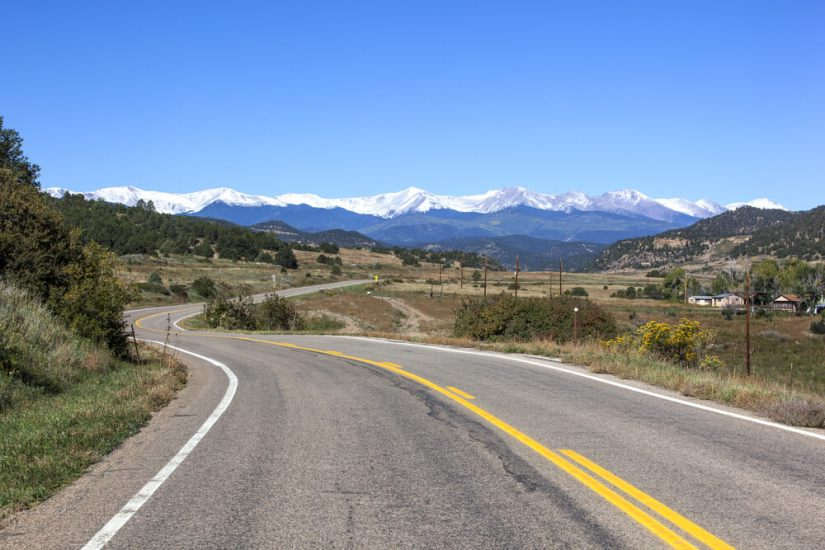 Highway of Legends winding through southwest Colorado on a sunny day