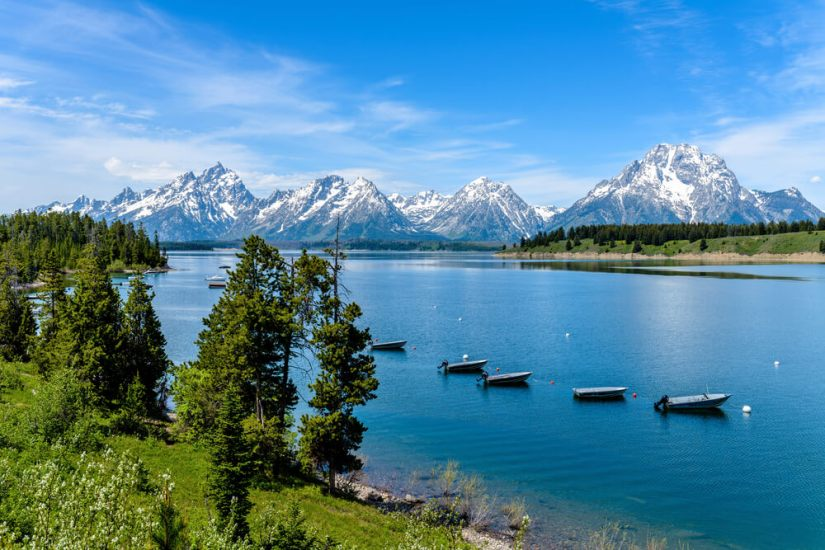 Boats on Jackson Lake in Grand Teton in summer
