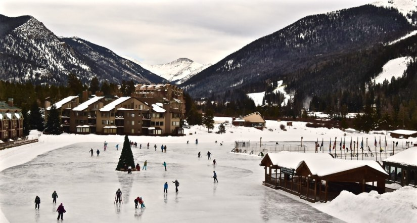people ice skating at the keystone ski resort in colorado, a popular day trip from denver in winter