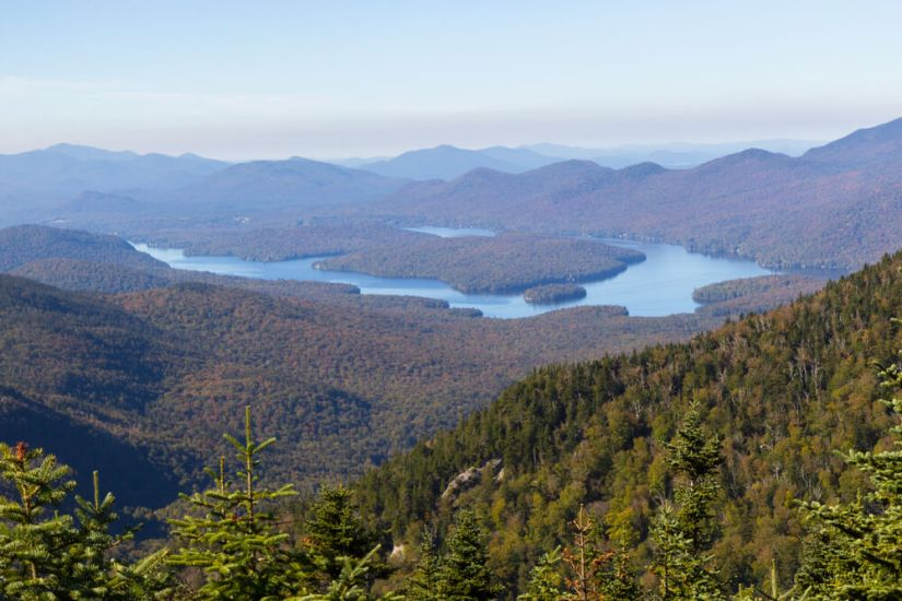 view from whiteface mountain over the mountains and waters of the lake placid