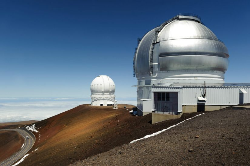 giant silver and white telescopes located on mauna kea in hawaii
