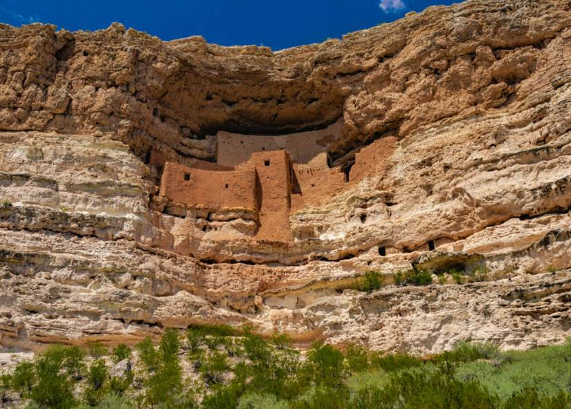 The scenic Montezuma Castle carved out of a cliff, a pueblo cliff dwelling of the ancient Indigenous peoples of Arizona