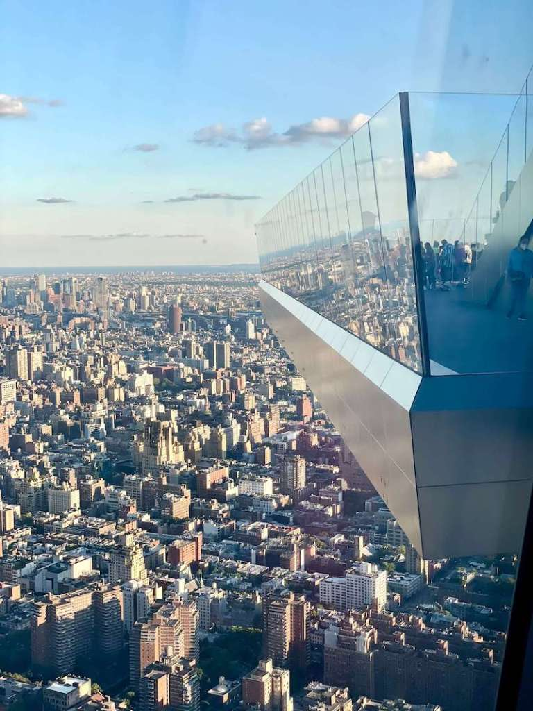 View of The Edge Observation Deck jutting out from the building as a sky deck on a sunny day in New york city