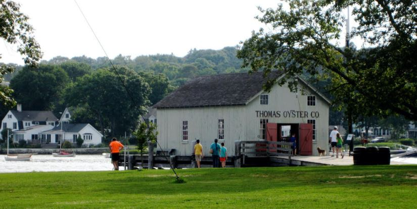 restaurant that reads thomas oyster co on the water