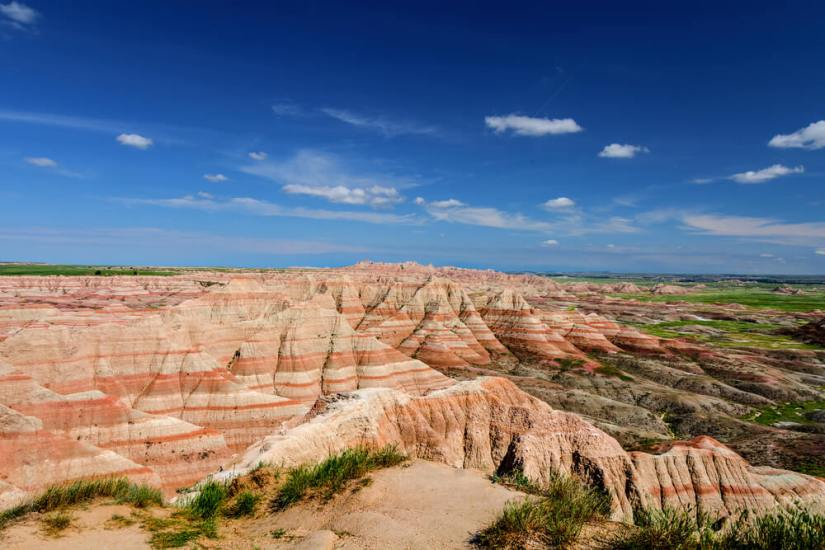 Striated red and tan rock and grasslands in the Badlands of South Dakota