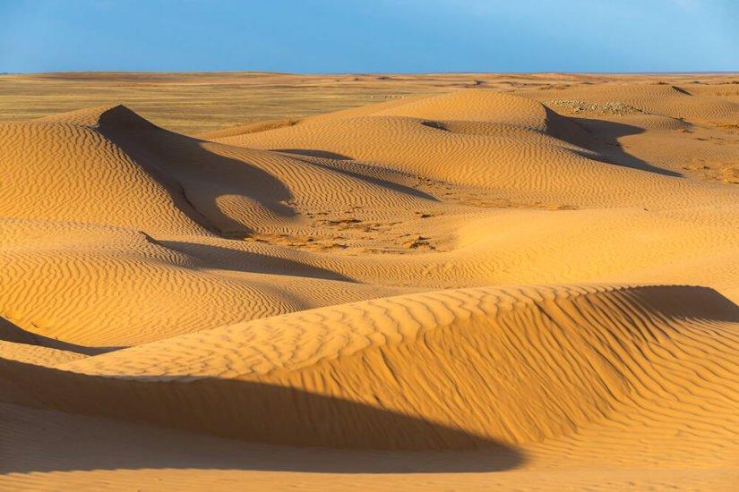 Ripples in the sand in the Sahara Desert beautiful orange sand