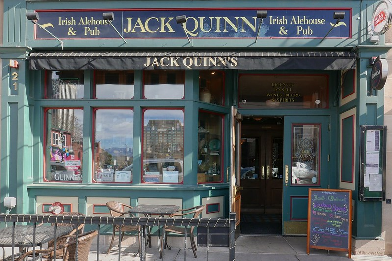 the green facade of the irish pub called jack quinn in colorado springs co -- a great spot to visit on a weekend in colorado springs itinerary