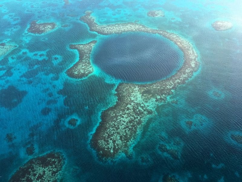 The blue hole in belize, as seen from above, a sinkhole surrounded by a reef