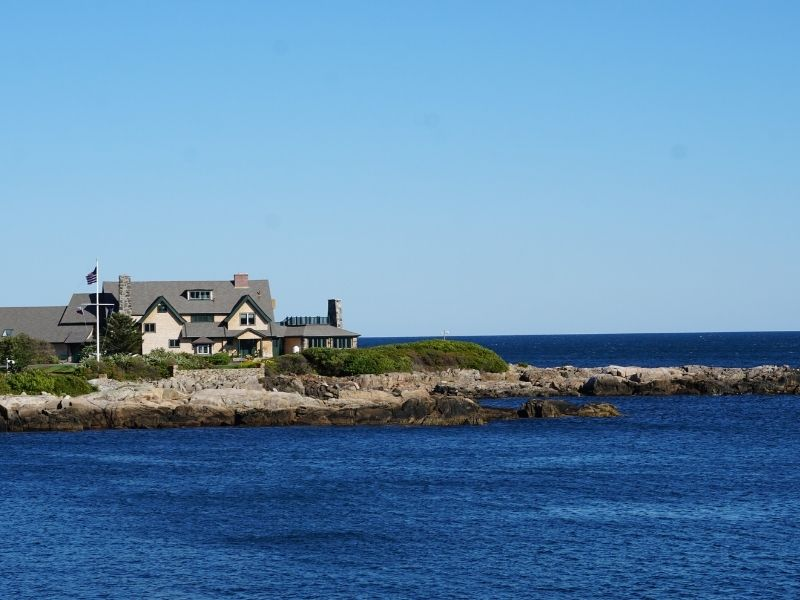 the famous bush compound where the bush family summers in maine on the water at walkers point on a sunny day