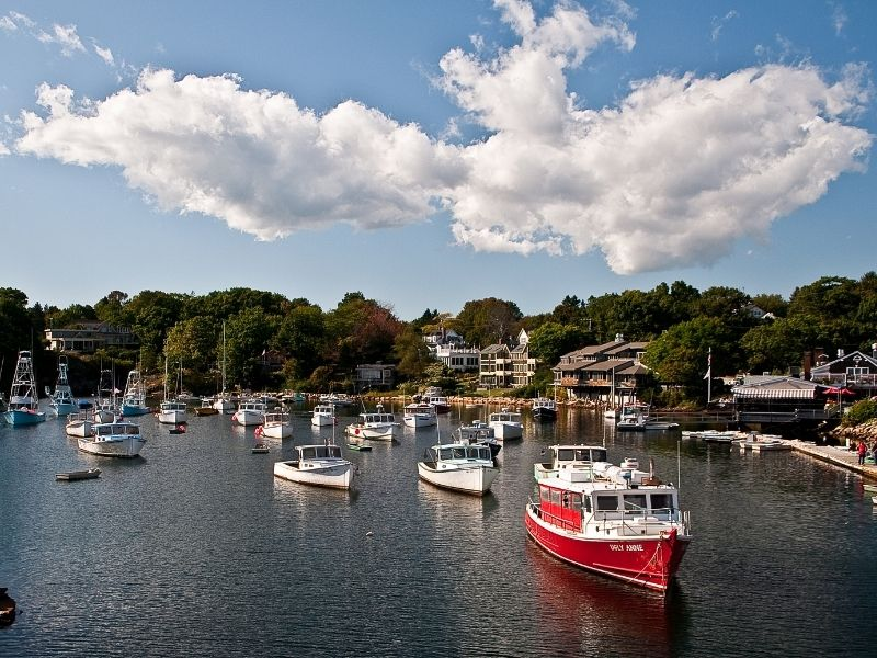 Many boats in the marina of Ogunquit on a sunny day in Maine along the coast