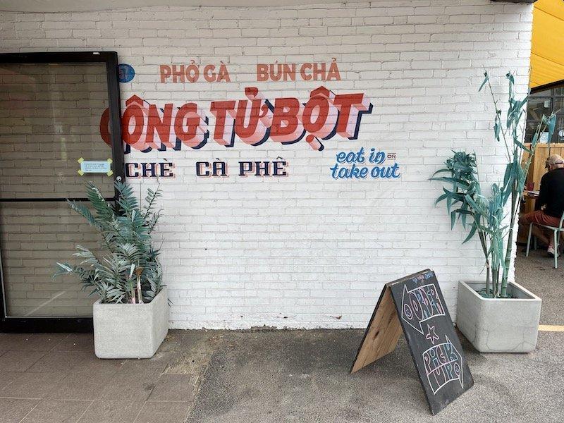 facade of a vietnamese restaurant with the words pho ga, bun cha, cong tu bot on it.