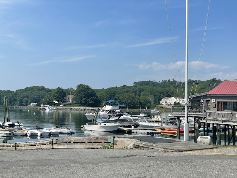 Boats and kayaks in the harbor of the Damariscotta River on a sunny day in summer