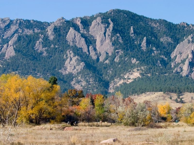 fall foliage in boulder colorado changing in front of the rocky mountains flatirons