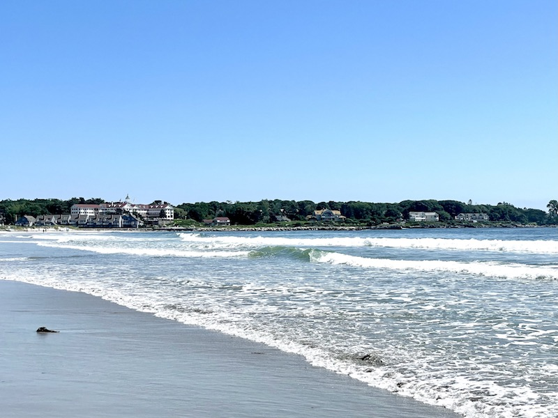 Waves crashing on Kennebunkport beach on a sunny day in Maine in summer