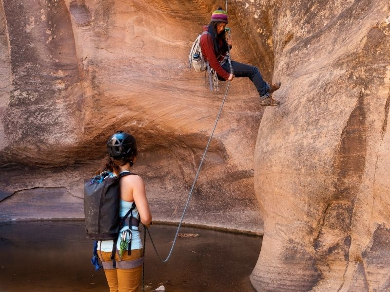 Two women enjoying canyoneering in Moab