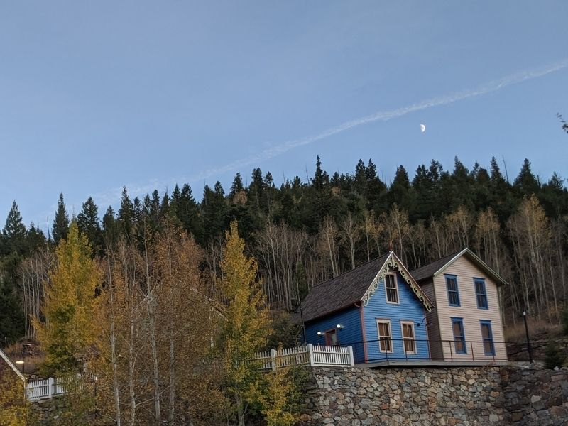 two cute houses sitting side by side each other in colorado mountains in central city