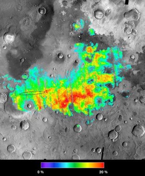 O mapa colorido representa os percentuais da presença da Hematita no Planum Meridiani em Marte: de 5% (aqua) até 25% (vermelho). O robô explorador Opportunity pousou dentro do oval negro. Crédito: NASA