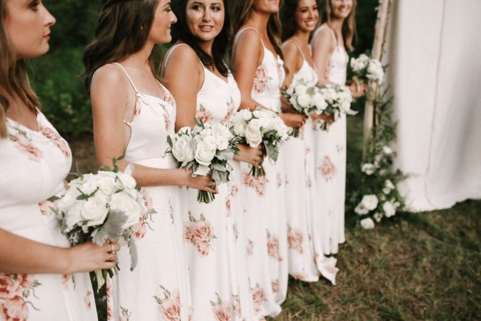 surrounded by a great community of people like her bridesmaids in Reformation dresses