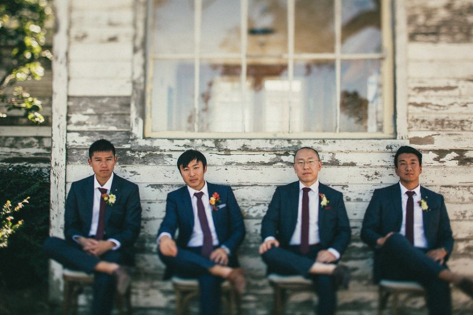 Groom and groomsmen sitting next to each other