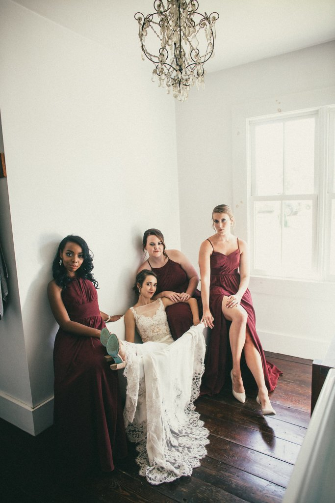 Bride poses dramatically in front of her bridesmaids