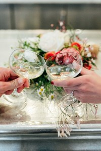 ethically dressed bride and her husband on their wedding day with champagne in San Francisco