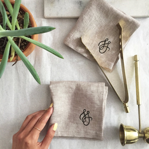 Customized linen near plant and hand