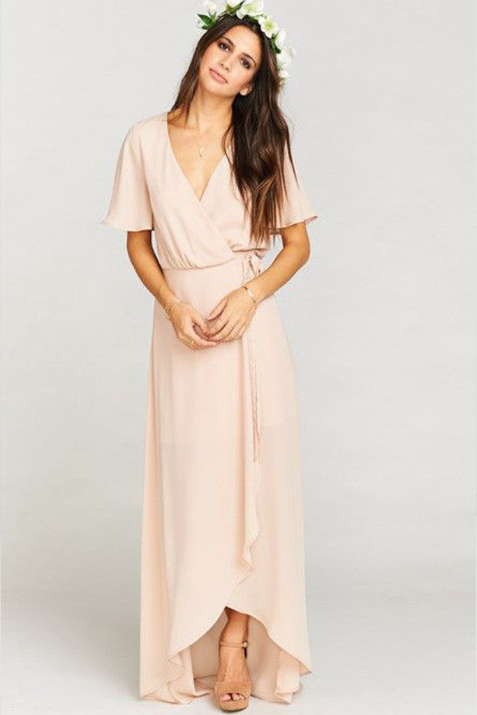 A simple, earthy bridal party wrap dress in blush pink. Dress rentals are a great option if you're interested in ethical wedding fashion.