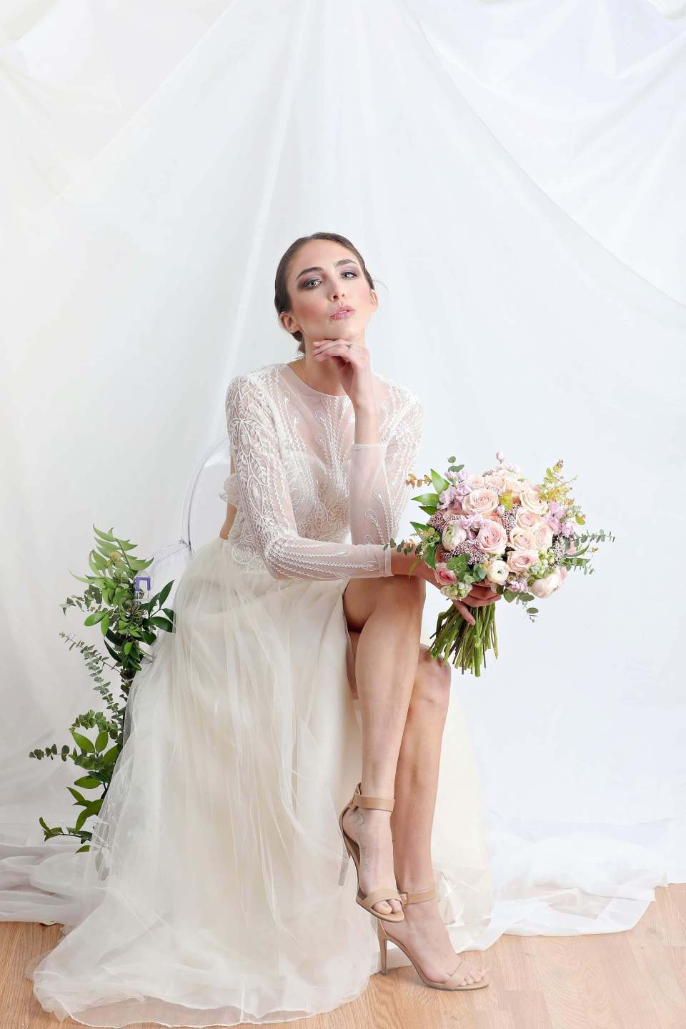 A portrait of a model bride wearing a sustainable wedding dress.