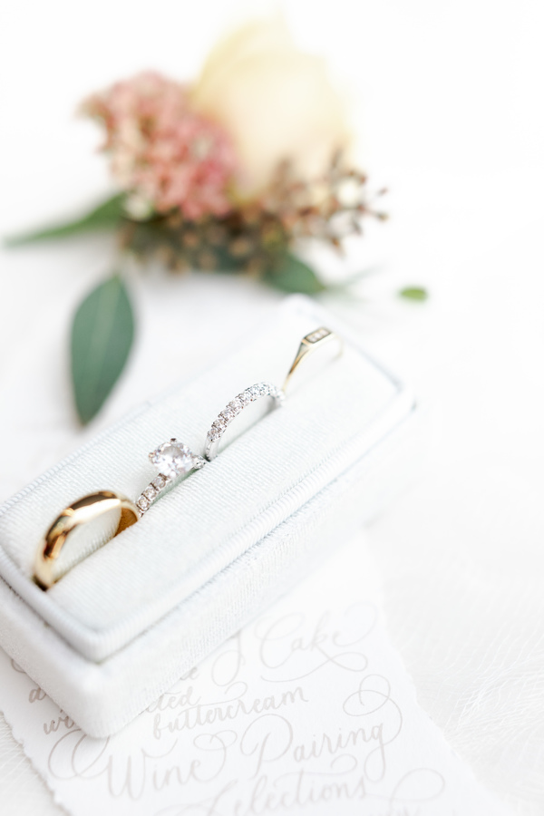 A flatlay of the bride and groom's ethically sourced engagement rings.