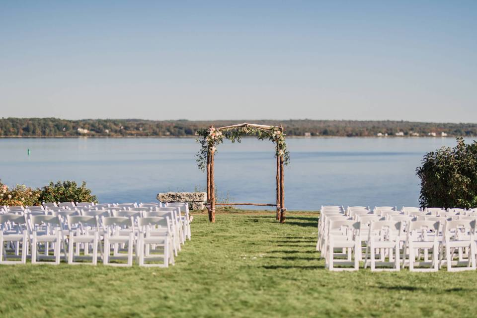 A photo of the lawn ceremony at Monica and Gideon's intimate waterfront wedding.