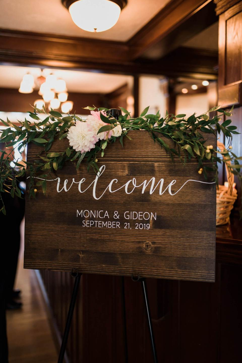 A welcome sign at the intimate waterfront wedding of Gideon and Monica.