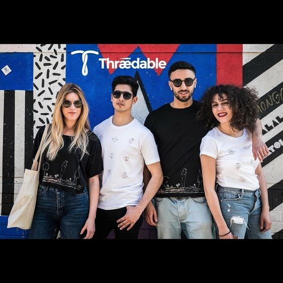 Models wearing Thraedable t-shirts