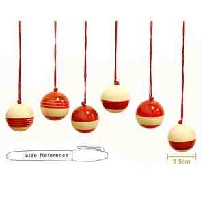 red wooden baubles sold by Ethiqana a shop specialising in eco friendly products, earth friendly products and sustainable products.