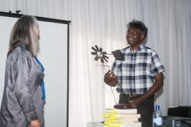 Lien Botha presents Darryl David with the Order of the Wind Pump as recognition for his initiatives and hard work as organiser of many festivals around the country. (Photo: Amy Coetzer)