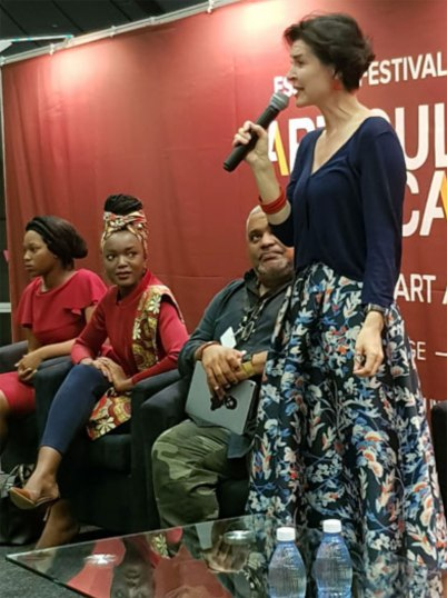 Poet Isobel Dixon captivates the audience with her moving lyrics in the Pecha Kucha poetry showcase.