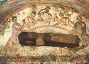 Fresco of female figure holding chalice in the Agape Feast. Catacomb of Saints Pietro e Marcellino (Saints Marcellinus and Peter), Via Labicana, Rome, Italy. Courtesy of Wikimedia Commons