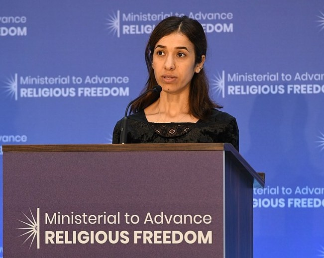 Nadia Murad, a prominent Yazidi human rights activist and survivor of ISIS gender-based violence, delivers remarks at the Ministerial to Advance Religious Freedom at the U.S. Department of State in Washington, D.C., 22 February 2016. Courtesy of Wikimedia Commons