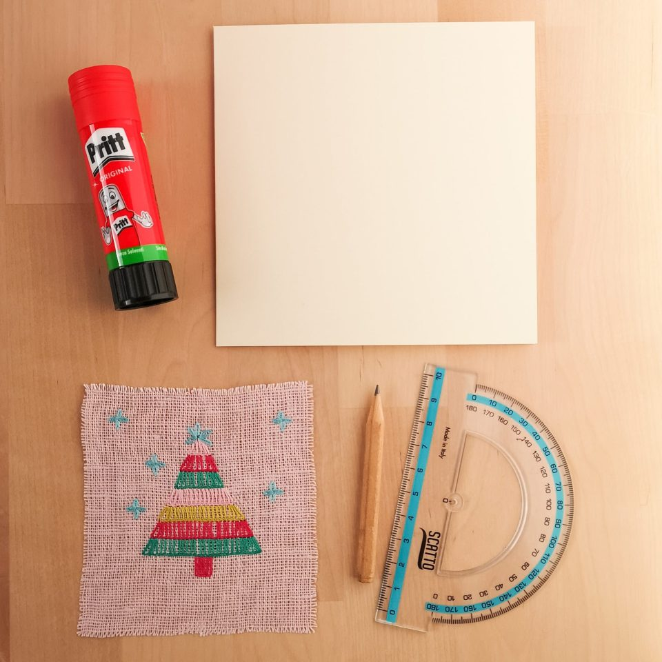 Materials for making a greetings card, glue, ruler, pencil, embroidery, paper card