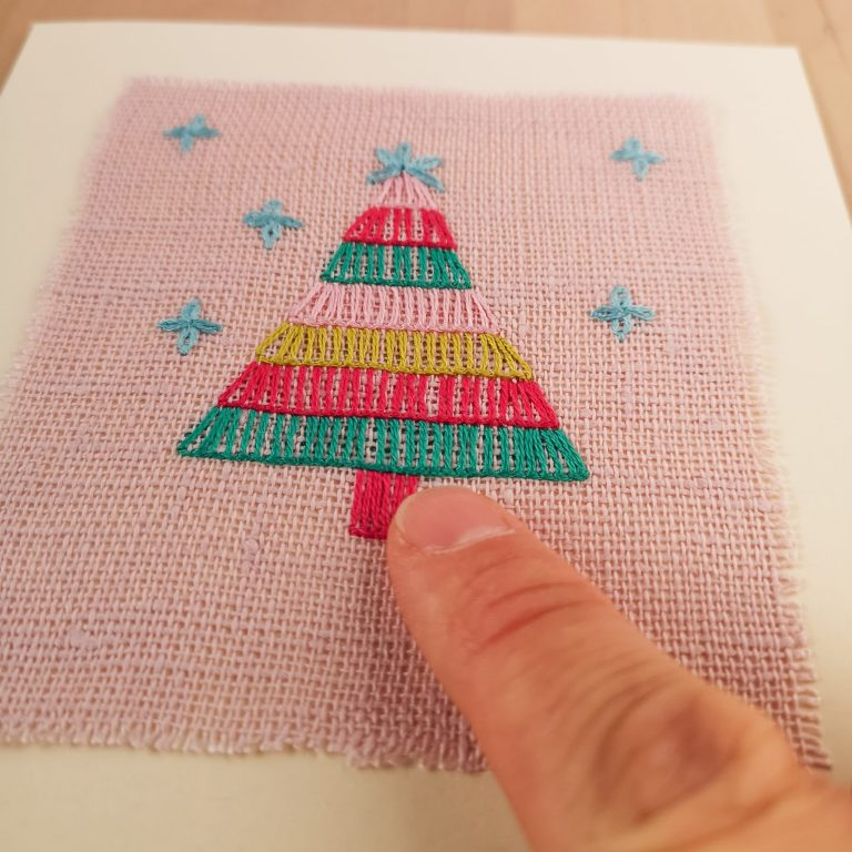 Attaching the embroidery on the card