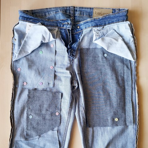 Pin the patches to jeans