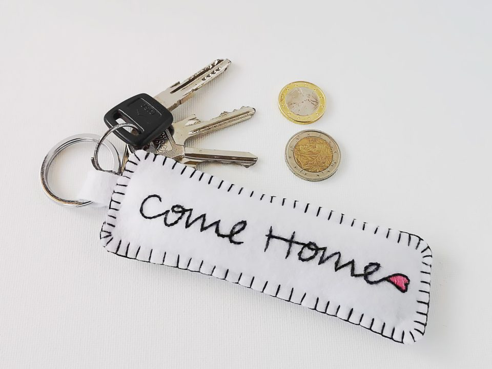 Key chain with embroidered Come Home phrase