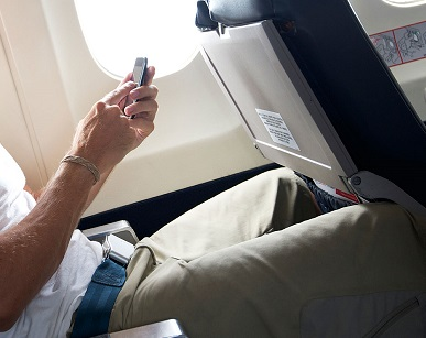 Travel law: Unruly passenger – FAA employee refuses to turn off cell phone