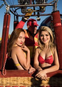 Beautiful young bikini flight attendants participate in Balloon Fiesta