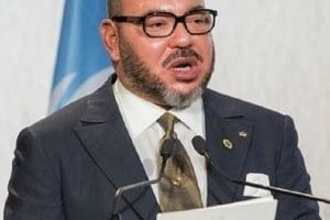 Where is the King of Morocco traveling on vacation?