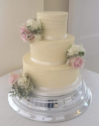 Buttercream spots and stripes wedding cake
