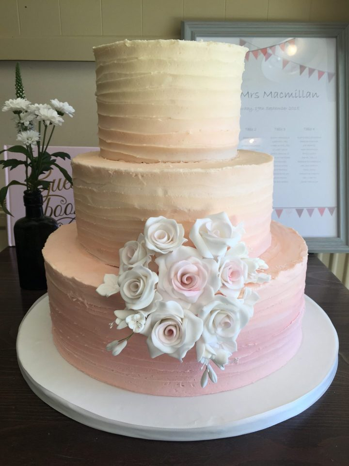 Ombre buttercream wedding cake with sugar roses