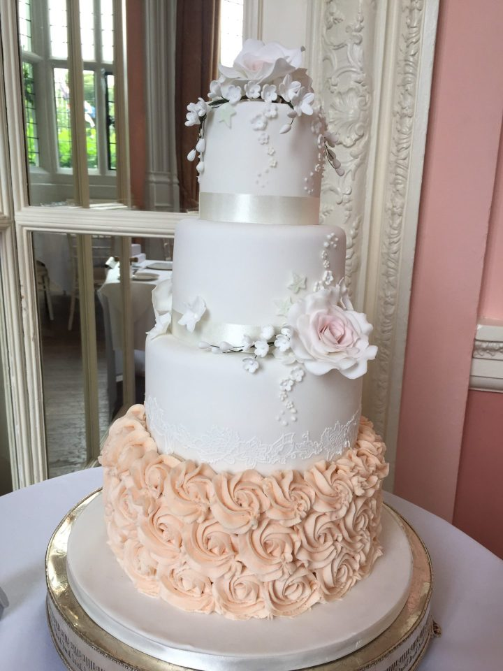 Rose and buttercream wedding cake
