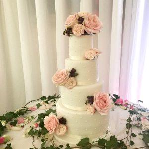 fullsizeoutput_3a2aPolka Dot Wedding Cake with Fresh Flowers