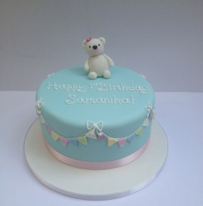 Teddy and bunting cake